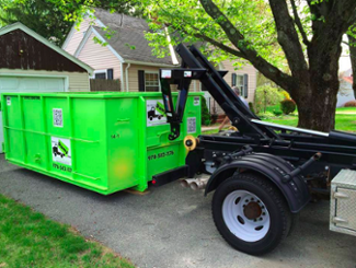 Hooklift Truck Picking Up Roll Off Dumpster